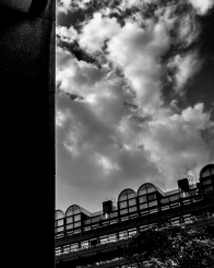 Straight edges and clouds collide. Barbican Centre, London. Pentax Q.