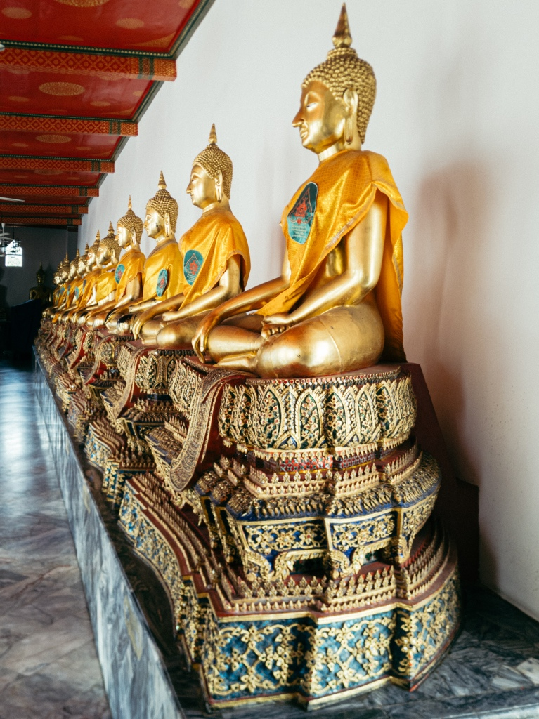 A row of Buddha statues in a temple