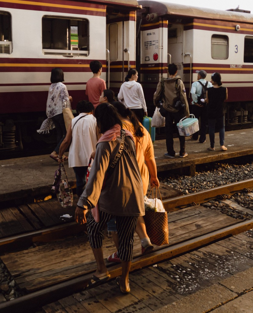 Thai people boarding the morning train at dawn