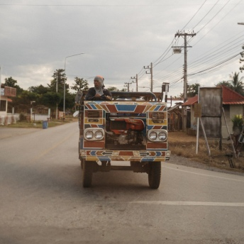 Thai Rice Farmer in his Tractor