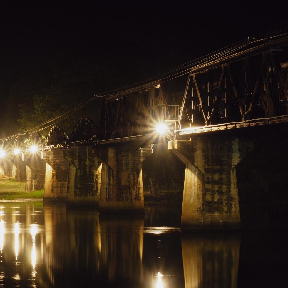Bridge over the River Kwai illuminated at night