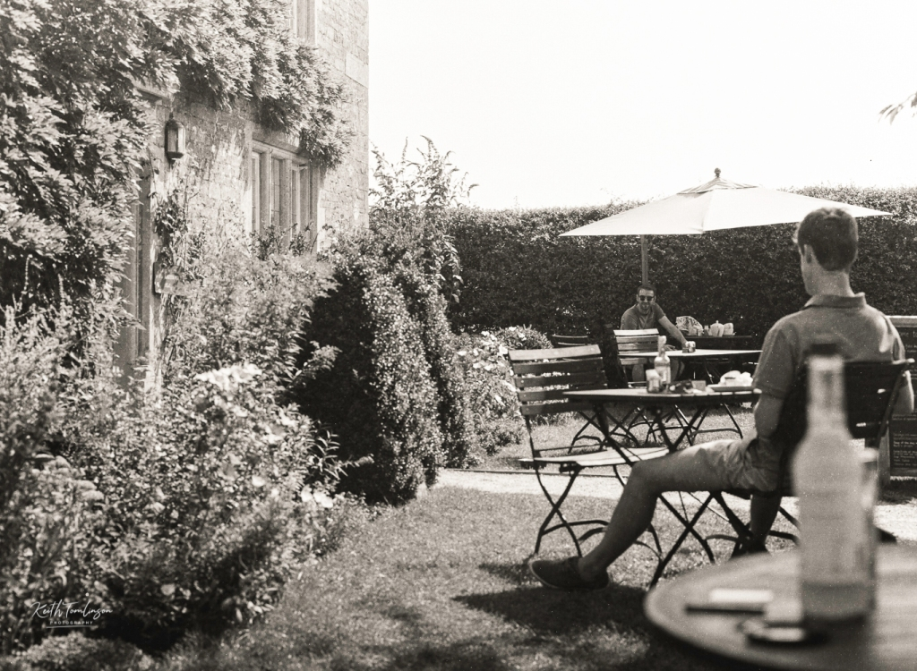 A photo of two men having lunch at a countryside cafe