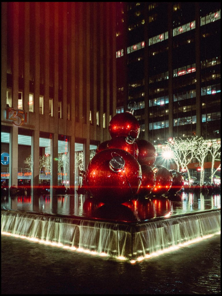 A photo of large festive baubles outside an office block in Manhattan