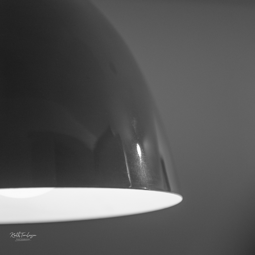 An interior black and white photo of a lampshade