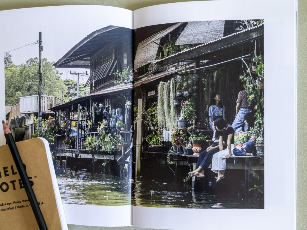 A look at the inside of the book featuring a photo of life from Bangkok's canals