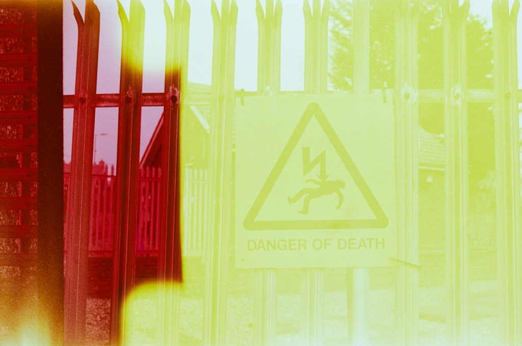The warning sign on the fencing of the local power hub
