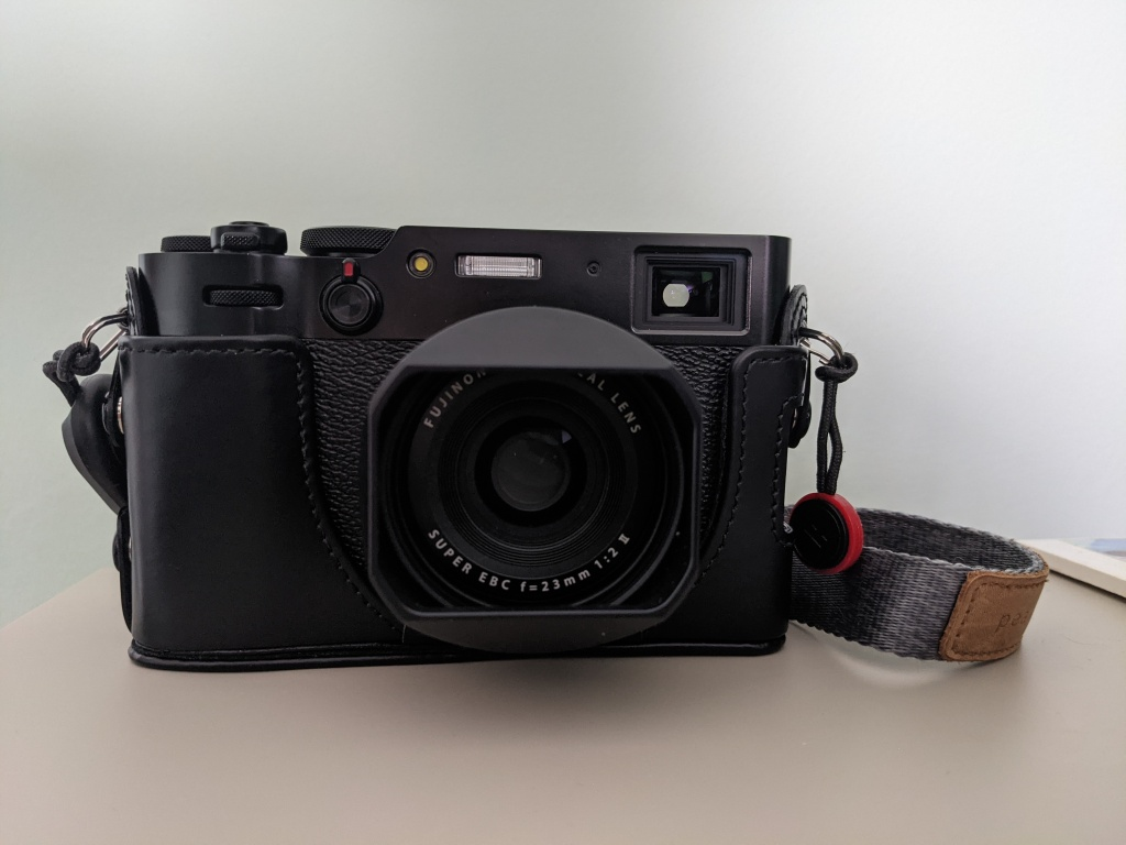A photo of my X100V camera with the lens hood attached