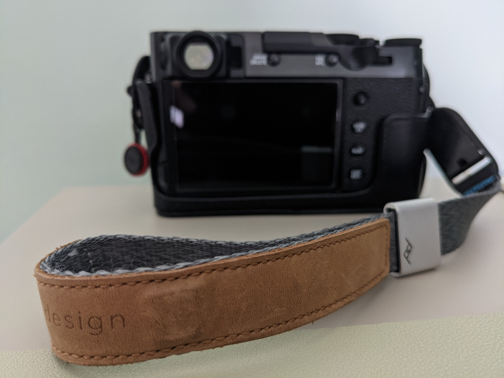 A photo of the wrist strap attached to my camera
