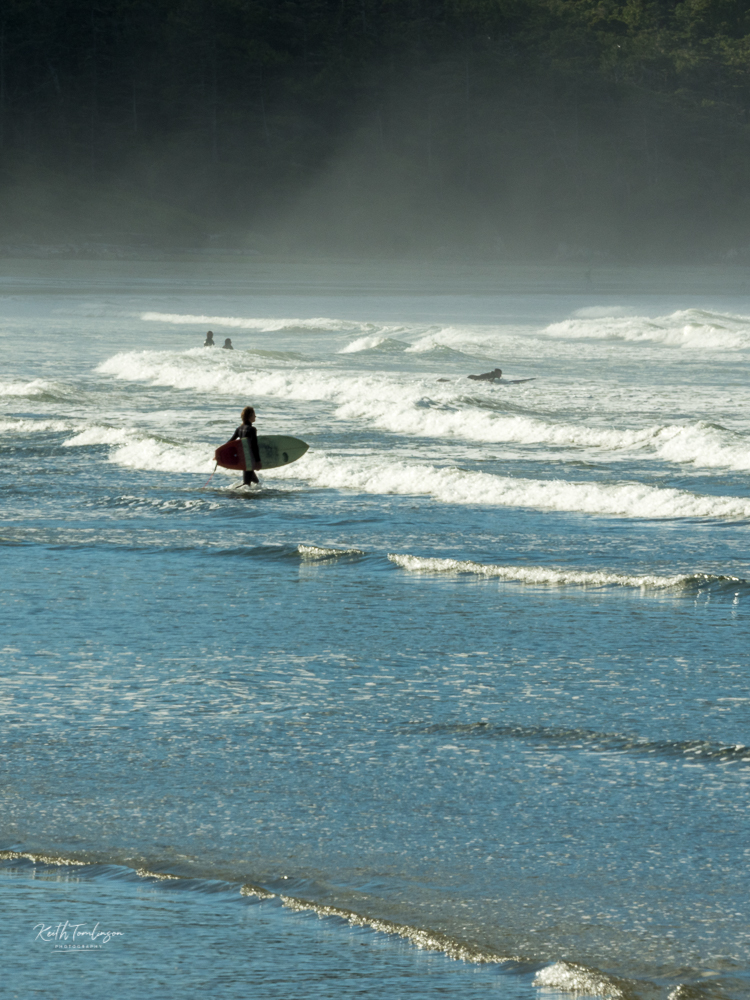 A surfer approaches the waves